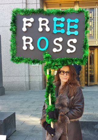 "<h2>Free Ross</h2> Michele Seven outside Federal District Court in Manhattan, January 2015. <p>Source:&nbsp;<a href=""https://insidebitcoins.com/news/ross-ulbricht-on-trial-protestors-defend-silk-road/28769"">insidebitcoins.com</a></p>"